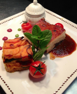 Slow braised pork belly with sweet potato and spinach gratin, red onion and chilli jam & apple & cinnamon jus