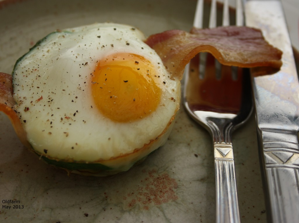 Baked egg, with bacon and sprinkle of black pepper